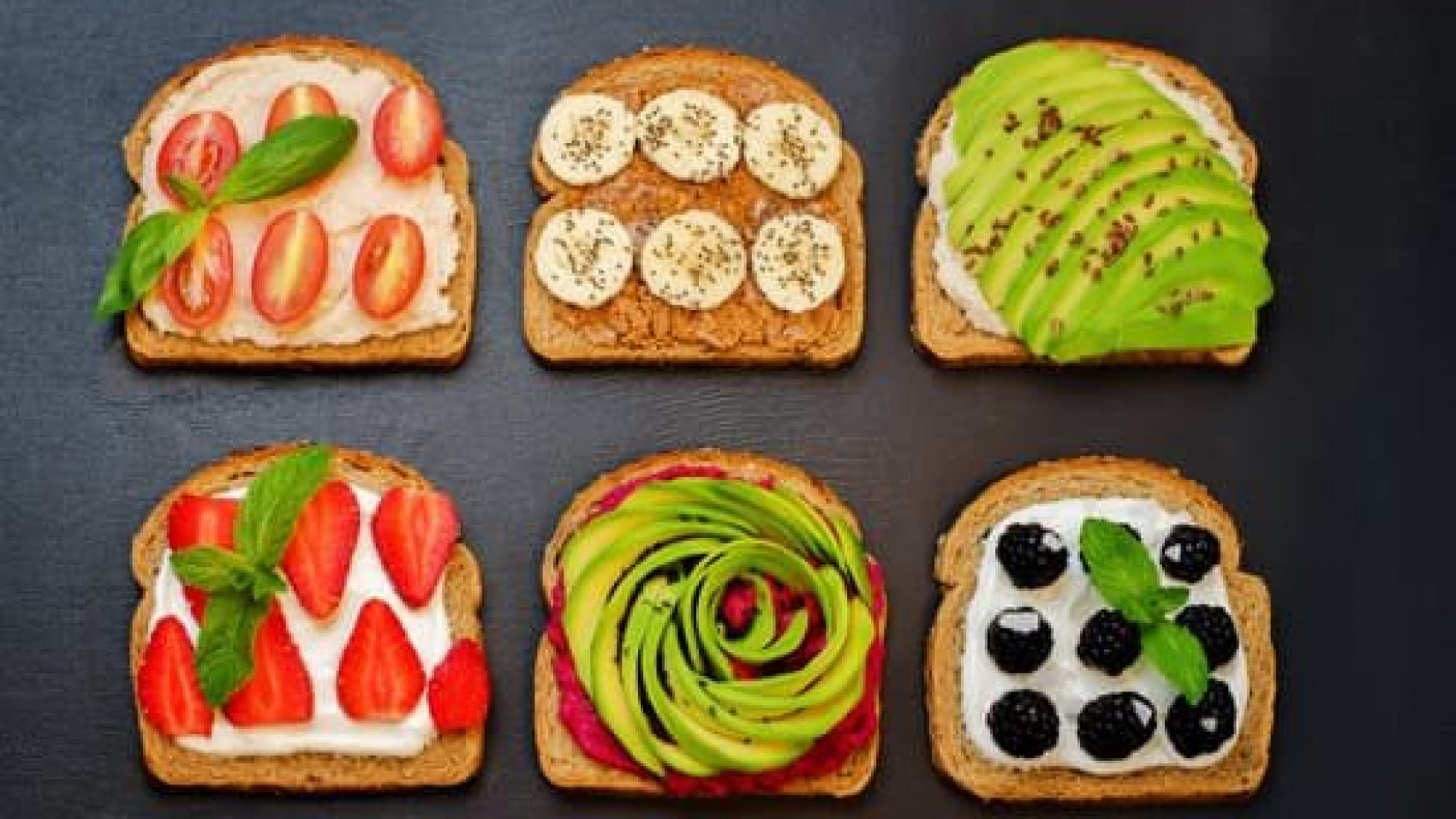 Variation of healthy rye breakfast sandwiches with avocado, hummus, and berries. toning. selective focus